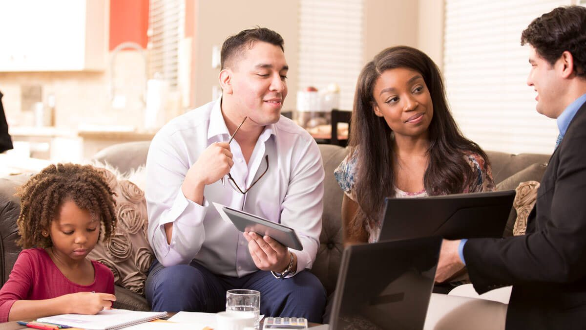 Couple asking their mortgage lender questions