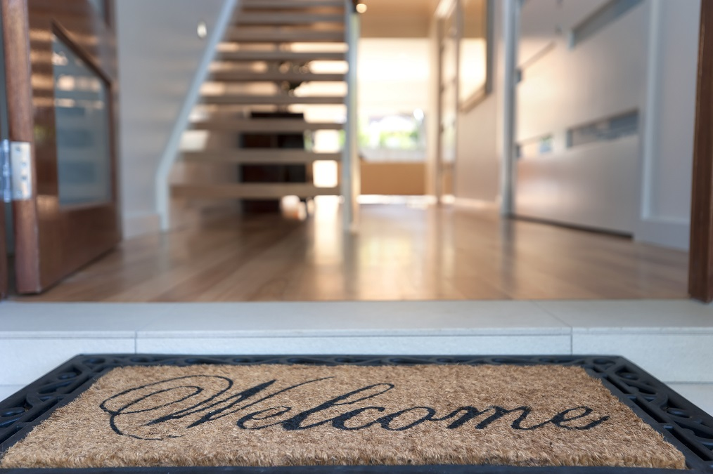 Welcome mat at a house's front door.