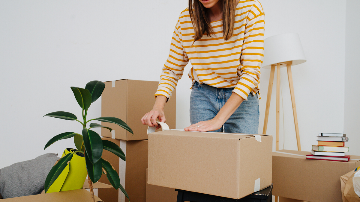 Woman packing to move to a new house